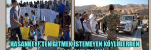 Hasankeyf'ten gitmek istemeyen köylülerden yol kesme eylemi
