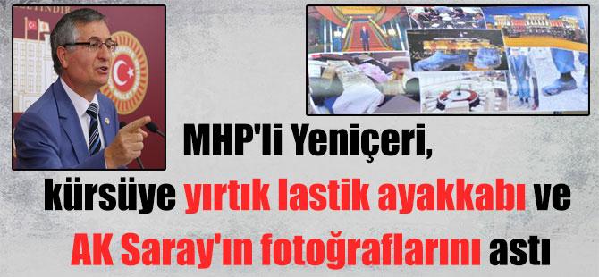 MHP'li Yeniçeri, kürsüye yırtık lastik ayakkabı ve AK Saray'ın fotoğraflarını astı