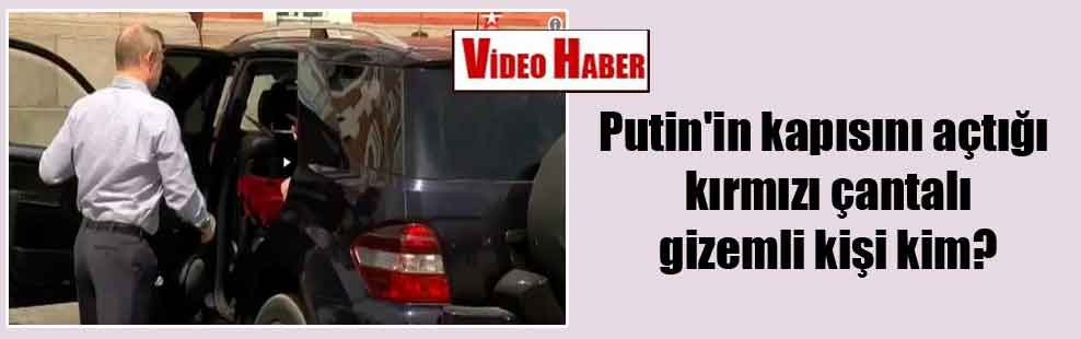 Putin'in kapısını açtığı kırmızı çantalı gizemli kişi kim?