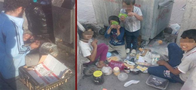 Çöpten topladığı birkaç yiyecek kırıntısına şükretti