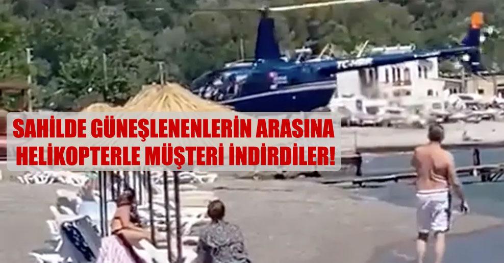 Sahilde güneşlenenlerin arasına helikopterle müşteri indirdiler!