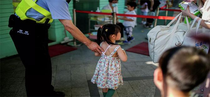 Çin'de yeniden artışa geçen Kovid-19 vakalarının kaynağı bir ilkokul